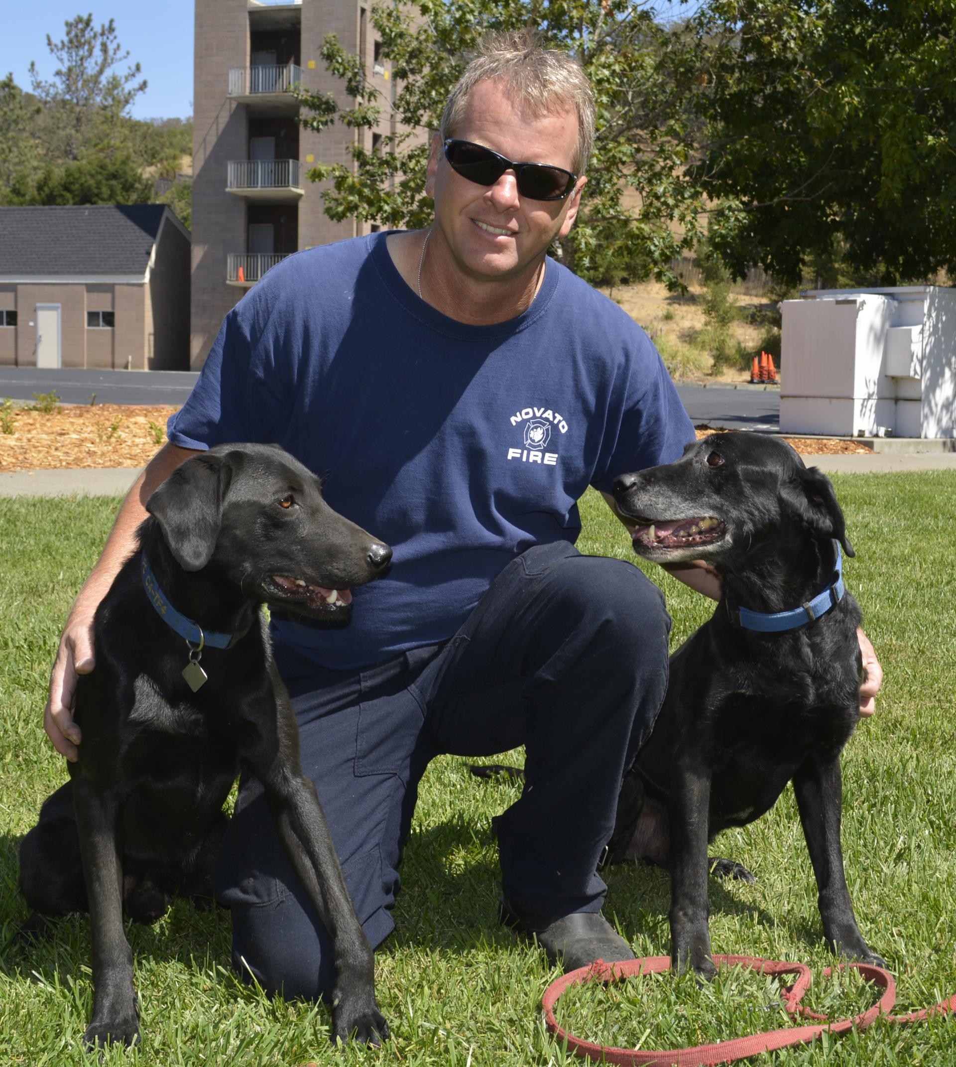 Mike Taul with dogs PC and Jeb